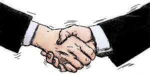 kädenpuristus ja sopimus on tehty eli sovittu